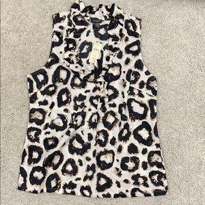 Ann Taylor NWT sleeveless shirt.  Size 12.